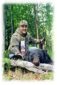 Photo of black bear and hunter