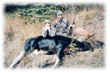 Two hunters with their large moose